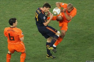 nigel-de-jong-fouls-polish-kid-during-the-training-of-euro-2012-02